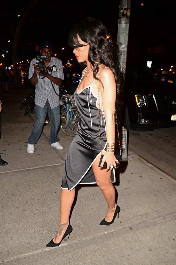 Rihanna seen wearing revealing black dress as she leaves for a birthday party at the Bowery Hotel in New York City